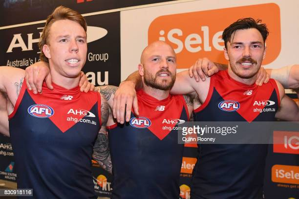 James Harmes Nathan Jones and Michael Hibberd of the Demons sing the song in the rooms after winning the round 21 AFL match between the Melbourne...