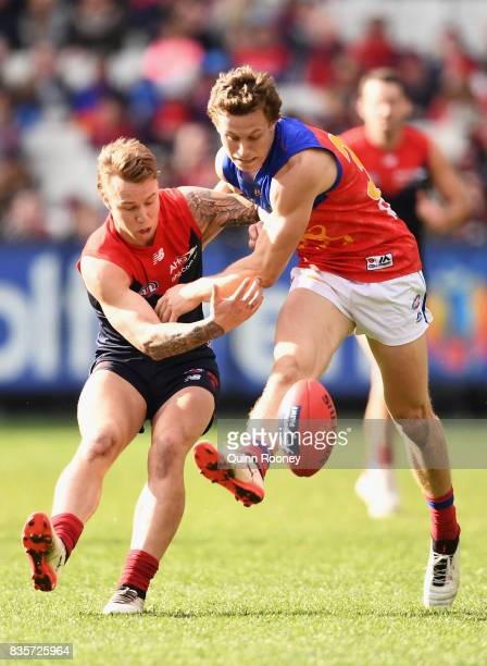 James Harmes of the Demons and Ryan Lester of the Lions compete for the ball during the round 22 AFL match between the Melbourne Demons and the...