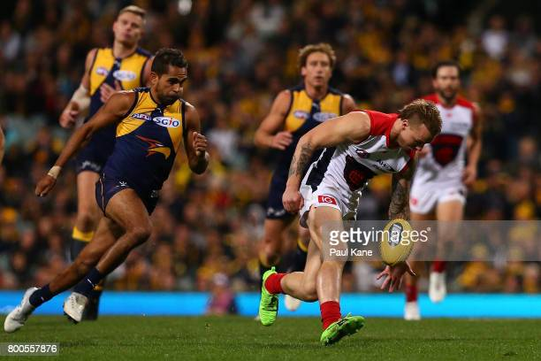 James Harmes of the Demons gathers the ball during the round 14 AFL match between the West Coast Eagles and the Melbourne Demons at Domain Stadium on...