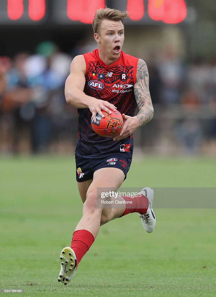 James Harmes of the Demons runs with the ball during the round 10 AFL match between the Melbourne Demons and the Port Adelaide Power at Traeger Park on May 28, 2016 in Alice Springs, Australia.