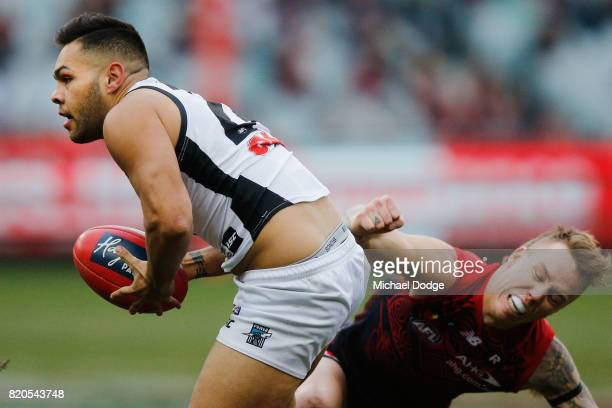 James Harmes of the Demons tackles Jarman Impey of the Power during the round 18 AFL match between the Melbourne Demons and the Port Adelaide Power...