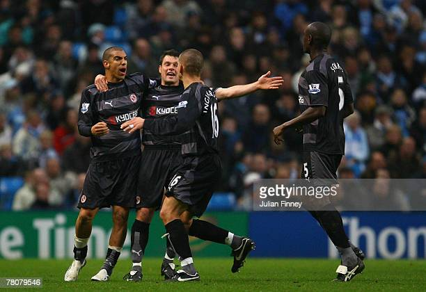 James Harper of Reading is congratulated by teammates Graeme Murty Ivar Ingimarsson and Ibrahima Sonko after scoring a goal during the Barclays...