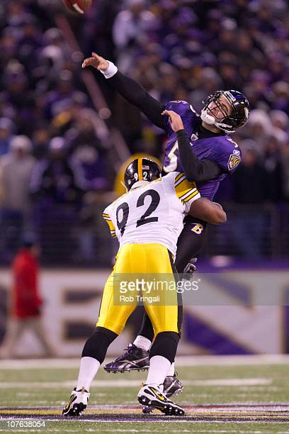 James Harrison of the Pittsburgh Steelers pressures Joe Flacco of the Baltimore Ravens as he attempt to pass during the game against the Baltimore...