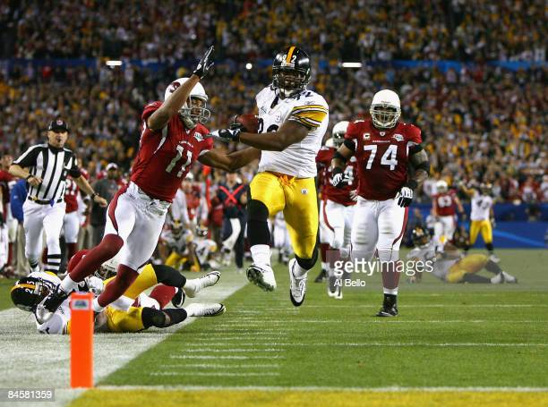 James Harrison of the Pittsburgh Steelers scores a touchdown after running back an interception for 100 yards in the second quarter against the...