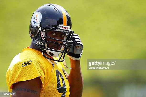 James Harrison of the Pittsburgh Steelers snaps in his chin guard during training camp on July 29 2011 at St Vincent College in Latrobe Pennsylvania