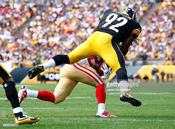 James Harrison of the Pittsburgh Steelers tackles Carlos Hyde of the San Francisco 49ers in the second half during the game at Heinz Field on...