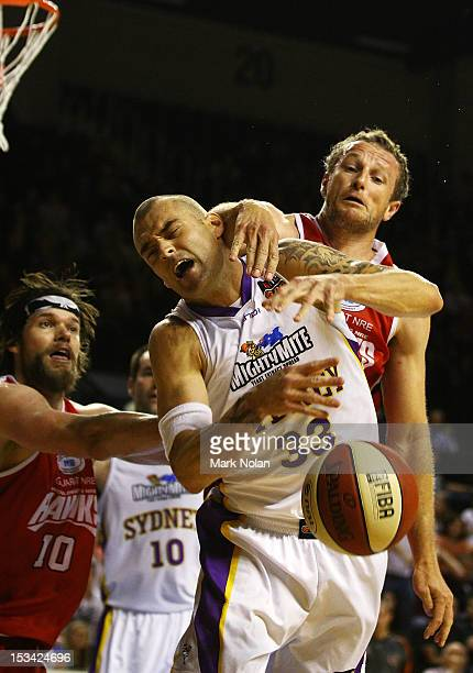 James Harvey of the Kings and Glen Saville of the Hawks contest possession during the round one NBL match between the Wollongong Hawks and the Sydney...