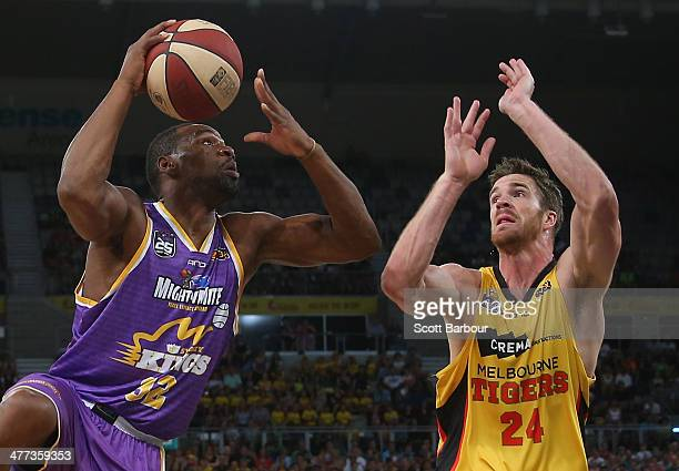 James Harvey of the Kings controls the ball as Lucas Walker of the Tigers defends during the round 21 NBL match between the Melbourne Tigers and the...