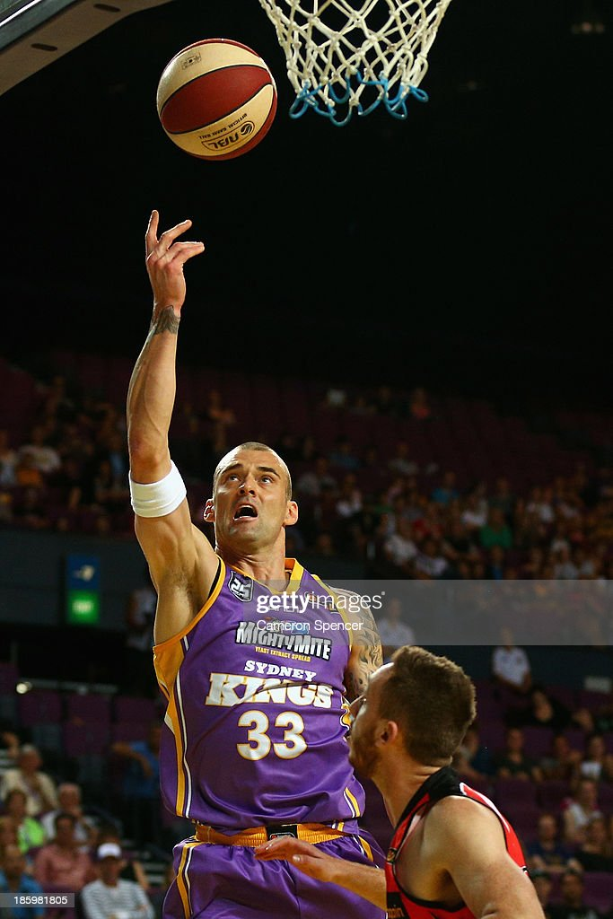 James Harvey of the Kings lays the ball up during the round three NBL match between the Sydney Kings and the Perth Wildcats at Sydney Entertainment Centre in October 27, 2013 in Sydney, Australia.