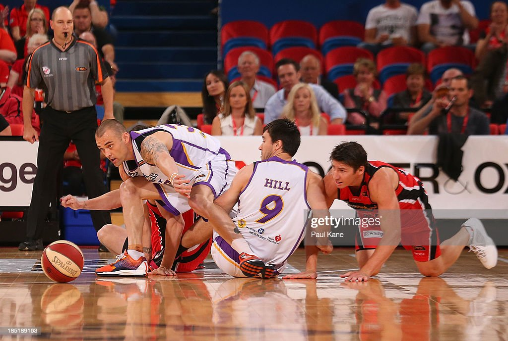 James Harvey of the Kings looks to gather a loose ball during the round two NBL match between the Perth Wildcats and the Sydney Kings at Perth Arena in October 18, 2013 in Perth, Australia.