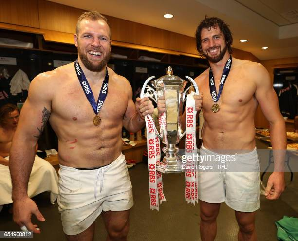James Haskell and Tom Wood celebrate with the Six Nations trophy during the RBS Six Nations match between Ireland and England at the Aviva Stadium on...