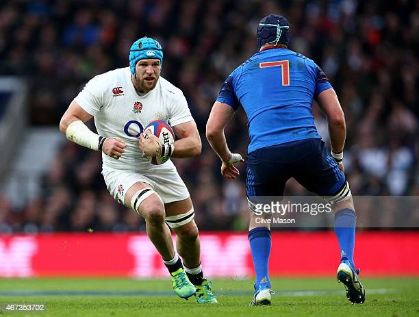 James Haskell of England is challenged by Bernard Le Roux of France during the RBS Six Nations match between England and France at Twickenham Stadium...