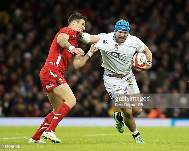 James Haskell of England is challenged by Mike Phillips of Wales during the RBS Six Nations match between Wales and England at the Millennium Stadium...