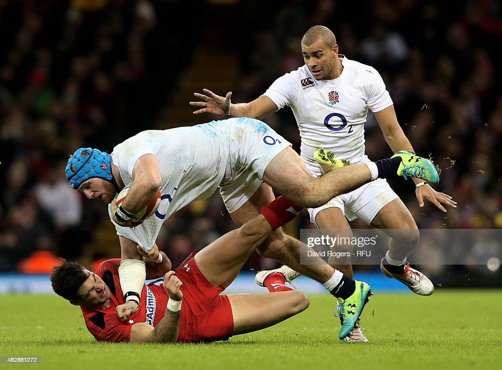 <a gi-track='captionPersonalityLinkClicked' href=/galleries/search?phrase=James+Haskell&family=editorial&specificpeople=539694 ng-click='$event.stopPropagation()'>James Haskell</a> of England is hauled down by Mike Phillips of Wales during the RBS Six Nations match between Wales and England at the Millennium Stadium on February 6, 2015 in Cardiff, Wales.