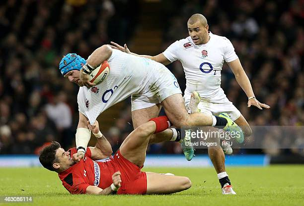 James Haskell of England is hauled down by Mike Phillips of Wales during the RBS Six Nations match between Wales and England at the Millennium...