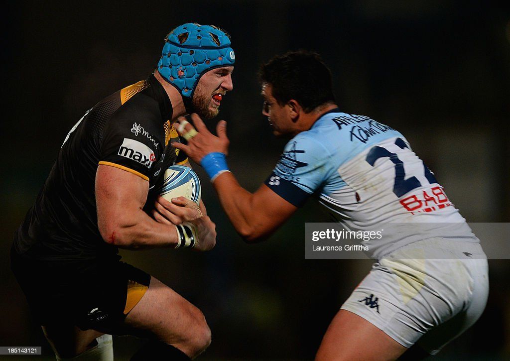 <a gi-track='captionPersonalityLinkClicked' href=/galleries/search?phrase=James+Haskell&family=editorial&specificpeople=539694 ng-click='$event.stopPropagation()'>James Haskell</a> of London Wasps is tackled by Guillaume Bernad of Bayonne during the Amlin Challenge Cup round two match between London Wasps and Bayonne at Adams Park on October 17, 2013 in High Wycombe, England.