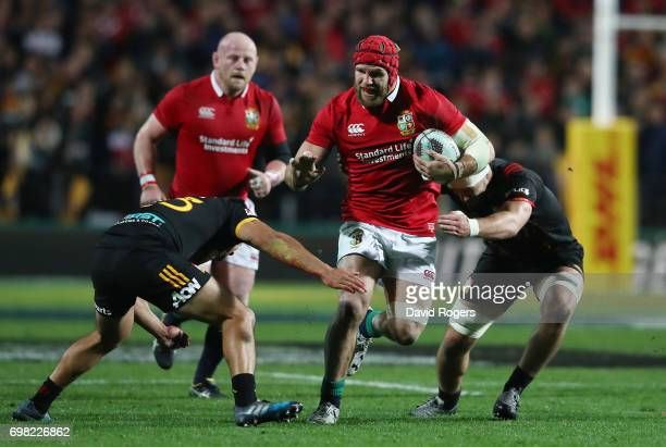 James Haskell of the Lions is tackled by Chase Tiatia of the Chiefs during the 2017 British Irish Lions tour match between the Chiefs and the British...