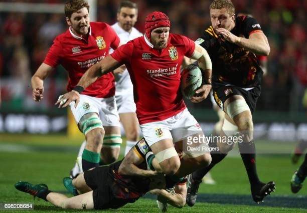 James Haskell of the Lions is tackled by Finlay Christie of the Chiefs during the 2017 British Irish Lions tour match between the Chiefs and the...