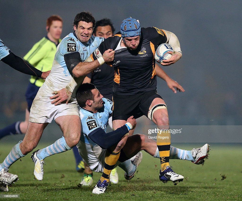 <a gi-track='captionPersonalityLinkClicked' href=/galleries/search?phrase=James+Haskell&family=editorial&specificpeople=539694 ng-click='$event.stopPropagation()'>James Haskell</a> of Wasps is tackled by Mike Phillips (L) and Thibault Lacroix during the Amlin Challenge Cup match between London Wasps and Bayonne at Adams Park on December 13, 2012 in High Wycombe, England.