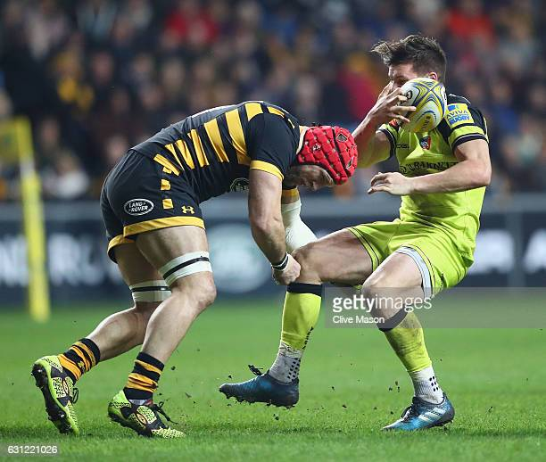 James Haskell of Wasps sustains a head injury as he tackles Freddie Burns of Leicester during the Aviva Premiership match between Wasps and Leicester...