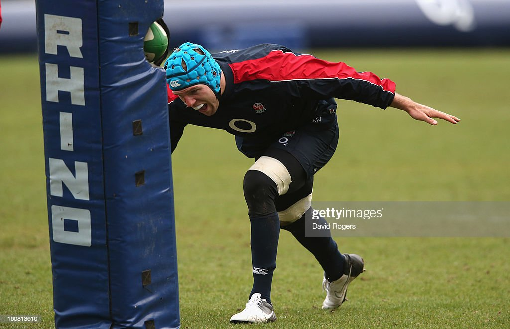 <a gi-track='captionPersonalityLinkClicked' href=/galleries/search?phrase=James+Haskell&family=editorial&specificpeople=539694 ng-click='$event.stopPropagation()'>James Haskell</a> practices his tackling during the England training session held at Pennyhill Park on February 6, 2013 in Bagshot, England.
