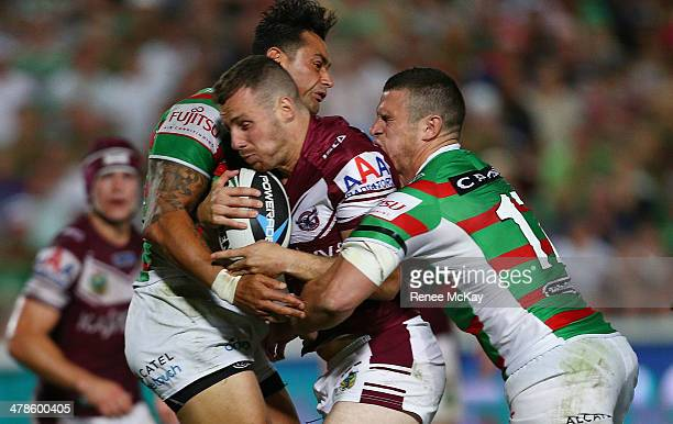 James Hasson of Manly is tackled by John Sutton and Luke Burgessduring the round two NRL match between the Manly Warringah Sea Eagles and the South...