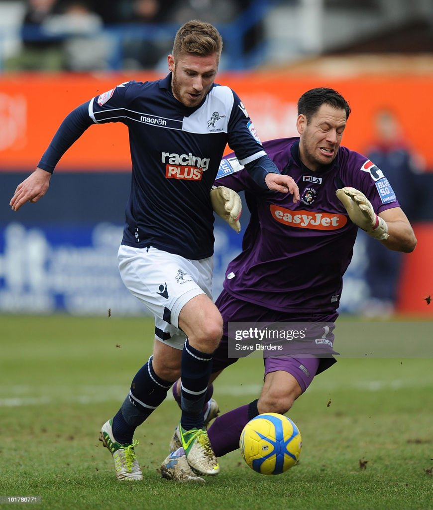 James Henry of Millwall FC rounds the Luton Town goalkeeper Mark Tyler to score the opening goal during the FA Cup with Budweiser Fifth Round Match between Luton Town and Millwall FC at Kenilworth Road on February 16, 2013 in Luton, England.
