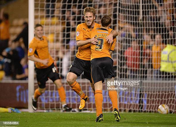 James Henry of Wolves celebrates scoring the first goal with team mate Leigh Griffiths during the Sky Bet League One match between Wolverhampton...