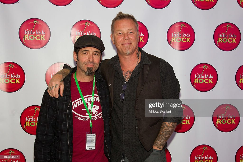 <a gi-track='captionPersonalityLinkClicked' href=/galleries/search?phrase=James+Hetfield&family=editorial&specificpeople=178297 ng-click='$event.stopPropagation()'>James Hetfield</a> and Jeff Campitelli arriving to Little Kids Rock fundraiser in Facebook HQ on November 9, 2013 in Menlo Park, California.