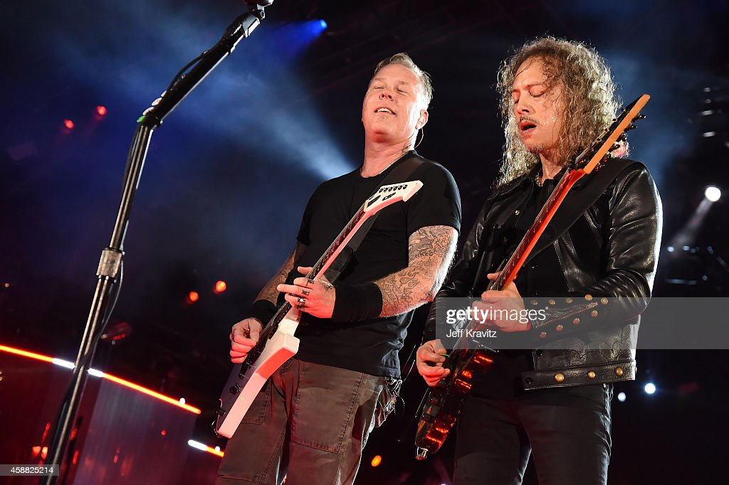 James Hetfield and Kirk Hammett of Metallica perform onstage during 'The Concert For Valor' at The National Mall on November 11, 2014 in Washington, DC.