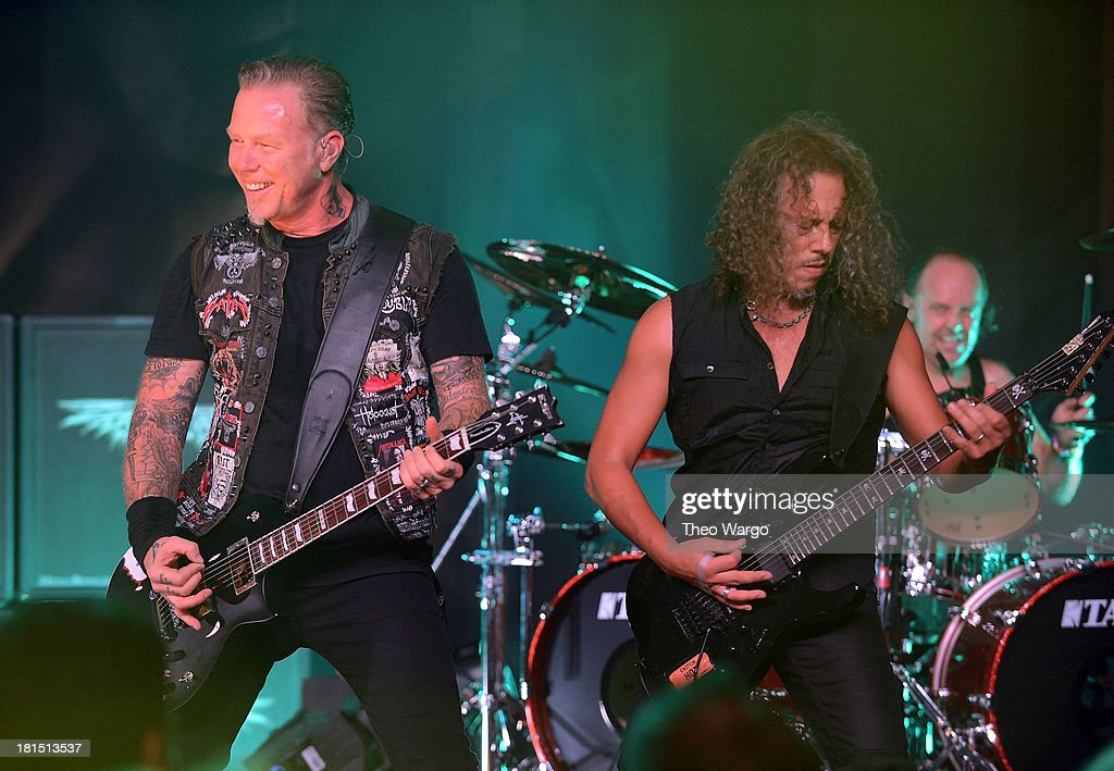 James Hetfield (L) and Kirk Hammett of Metallica perform private, exclusive concert for SiriusXM listeners at The Apollo Theater on September 21, 2013 in New York City.