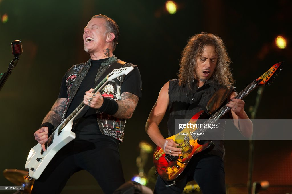 James Hetfield (L) and Kirk Hammett of the band Metallica perform on stage during a concert in the Rock in Rio Festival on September 19, 2013 in Rio de Janeiro, Brazil.