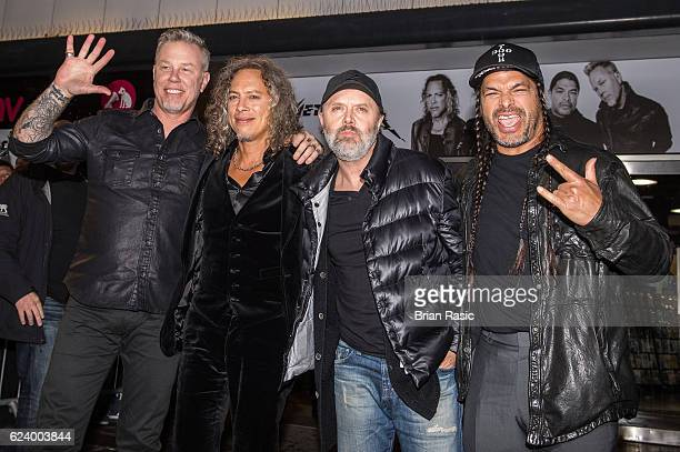 James Hetfield Kirk Hammett Lars Ulrich and Robert Trujillo of Metallica arrive for the midnight signing of their new album 'Hardwired to...