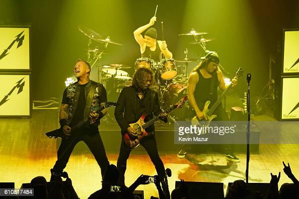 James Hetfield Kirk Hammett Lars Ulrich and Robert Trujillo of the heavy metal band Metallica perform during a special Fifth Memember fan club show...