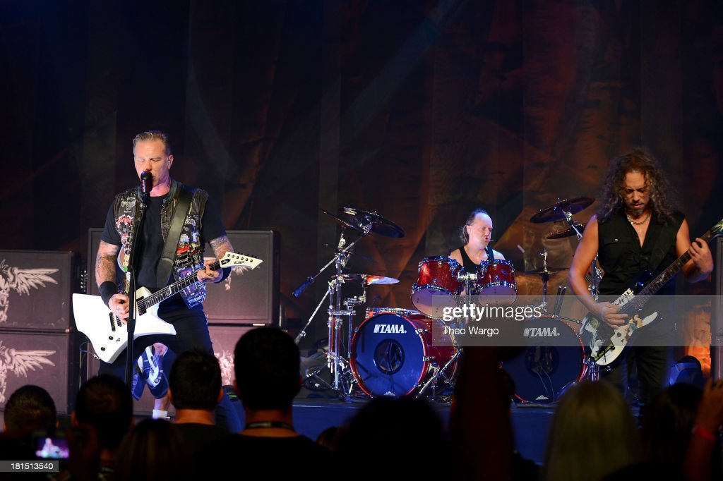 James Hetfield, Lars Ulrich and Kirk Hammett of Metallica perform private, exclusive concert for SiriusXM listeners at The Apollo Theater on September 21, 2013 in New York City.