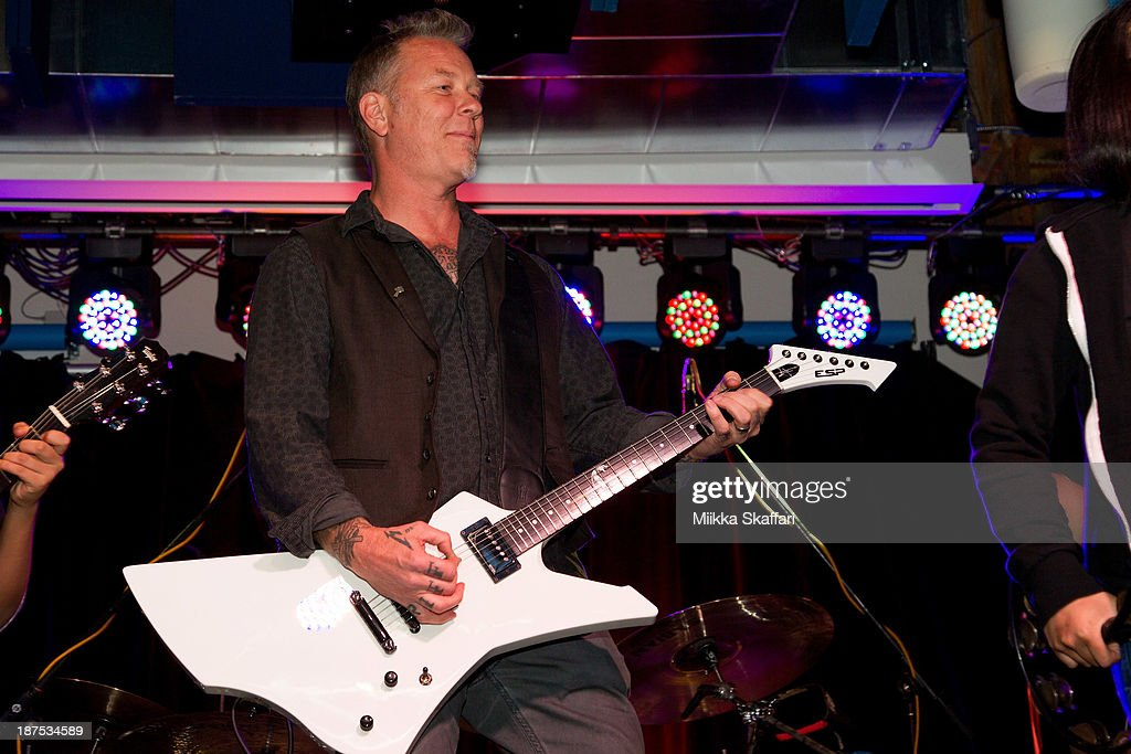 <a gi-track='captionPersonalityLinkClicked' href=/galleries/search?phrase=James+Hetfield&family=editorial&specificpeople=178297 ng-click='$event.stopPropagation()'>James Hetfield</a> performs with Little Kids Rock band at Little Kids Rock fundraiser in Facebook HQ on November 9, 2013 in Menlo Park, California.