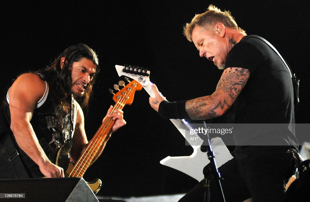 James Hetfield (R), the singer and guitarist for heavy rock band Metallica, performs with bassist Robert Trujillo (L) at the Rock in Rio music festival on September 25, 2011 in Rio de Janeiro. AFP PHOTO / ANDRE DURAO