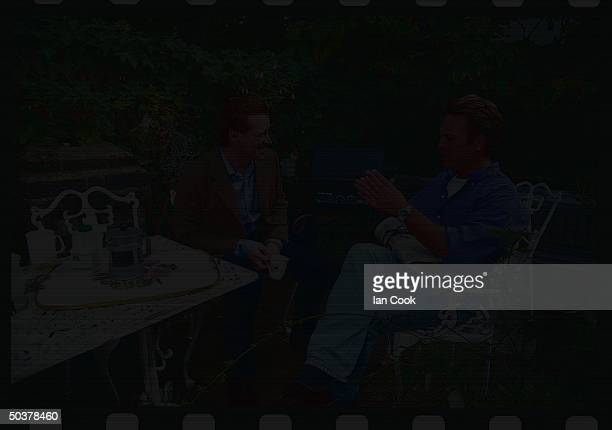 James Hewitt excavalry officer former lover of England's Princess Diana chatting w cavalry pal Rupert MacKenzieHill on his patio