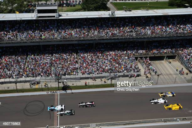 James Hinchcliffe driver of the Andretti Autosport Honda Dallara leads Ed Carpenter driver of the Fuzzy's Vodka / Ed Carpenter Racing Chevrolet...