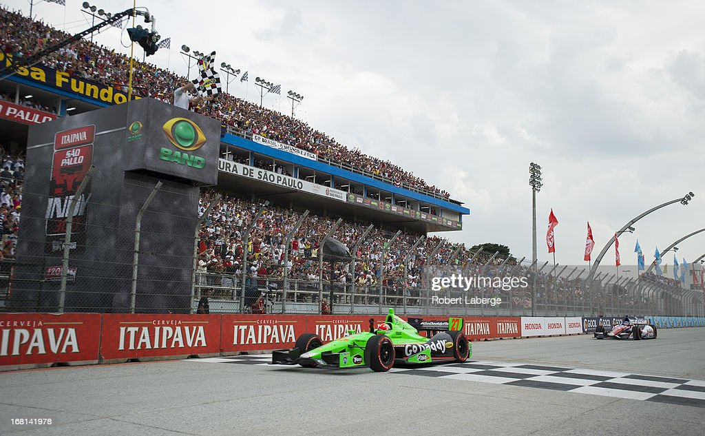 James Hinchcliffe of Canada driver of the #27 Andretti Autosport Dallara Chevrolet crosses the finish line in first place ahead of <a gi-track='captionPersonalityLinkClicked' href=/galleries/search?phrase=Takuma+Sato&family=editorial&specificpeople=203006 ng-click='$event.stopPropagation()'>Takuma Sato</a> of Japan driver of the #14 ABC Supply A. J. Foyt Racing Dallara Honda the IndyCar Series Sao Paulo indy 300 on May 5, 2013 in the streets of Sao Paulo in Sao Paulo, Brazil.