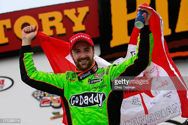 James Hinchcliffe of Canada driver of the GoDaddy Andretti Autosport Chevrolet celebrates in victory lane following his victory in the Iowa Corn Indy...
