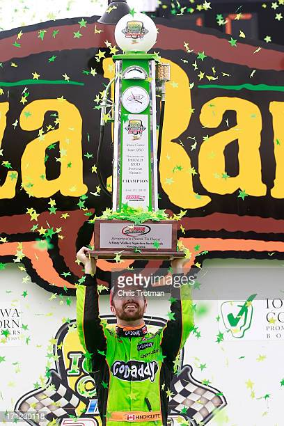 James Hinchcliffe of Canada driver of the GoDaddy Andretti Autosport Chevrolet lifts the trophy in victory lane following his victory in the Iowa...