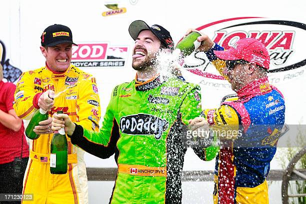 James Hinchcliffe of Canada driver of the GoDaddy Andretti Autosport Chevrolet is sprayed with champagne following his victory by second place...