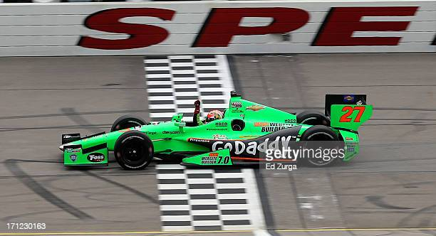 James Hinchcliffe of Canada driver of the GoDaddy Andretti Autosport Chevrolet takes the checkered flag as he wins the Iowa Corn Indy 250 at Iowa...