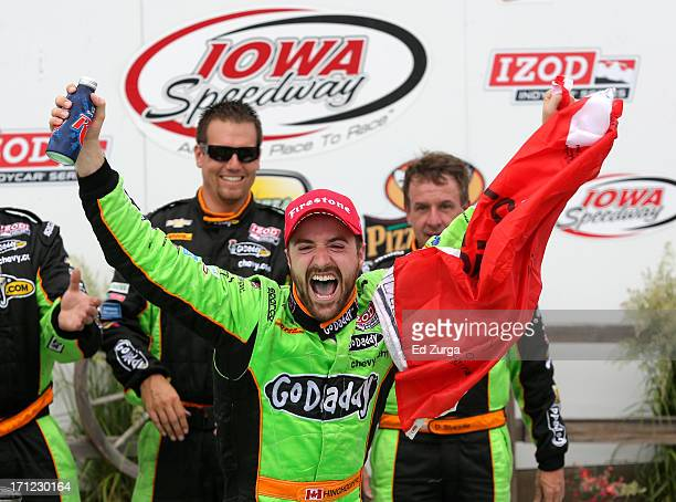 James Hinchcliffe of Canada driver of the GoDaddy Andretti Autosport Chevrolet celebrates after winning the Iowa Corn Indy 250 at Iowa Speedway on...