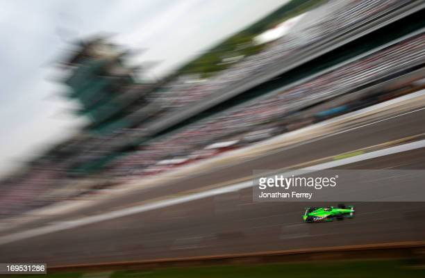 James Hinchcliffe of Canada driver of the GoDaddy Chevrolet races during the IZOD IndyCar Series 97th running of the Indianapolis 500 mile race at...