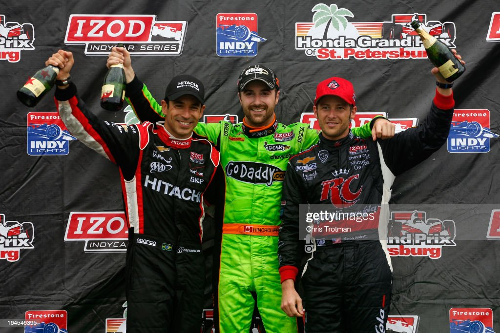 James Hinchcliffe of Canada, driver of the #27 GoDaddy.com Andretti Autosport Dallara Chevrolet stands on the podium with second placed (L) <a gi-track='captionPersonalityLinkClicked' href=/galleries/search?phrase=Helio+Castroneves&family=editorial&specificpeople=201776 ng-click='$event.stopPropagation()'>Helio Castroneves</a> of Brazil, driver of the #3 Hitachi Team Penske Chevrolet and third placed (R) <a gi-track='captionPersonalityLinkClicked' href=/galleries/search?phrase=Marco+Andretti&family=editorial&specificpeople=540446 ng-click='$event.stopPropagation()'>Marco Andretti</a> driver of the #25 RC Cola Andretti Autosport Chevrolet, following his victory in the IZOD IndyCar Series Honda Grand Prix of St Petersburg on March 24, 2013 in St Petersburg, Florida.