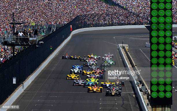 James Hinchcliffe of Canada driver of the Schmidt Peterson Motorsports Honda leads at the start of the 100th running of the Indianapolis 500 mile...