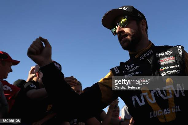 James Hinchcliffe of Canada driver of the Schmidt Peterson Motosports Honda greets fans as he is introduced to the Desert Diamond West Valley Phoenix...