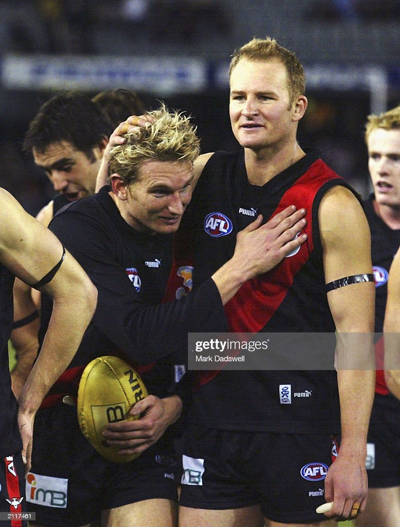 James Hird and Sean Wellman for the Bombers celebrate during the round 13 AFL match between the Essendon Bombers and the Geelong Cats at the Telstra...